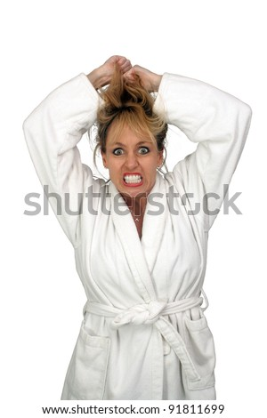 A lovely but insane, angry, or frustrated blonde, pulling her hair.  Isolated on a white background.