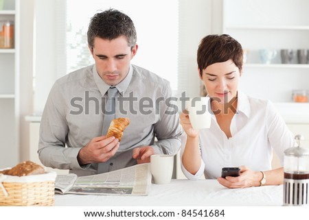 A lovely couple is having breakfast together