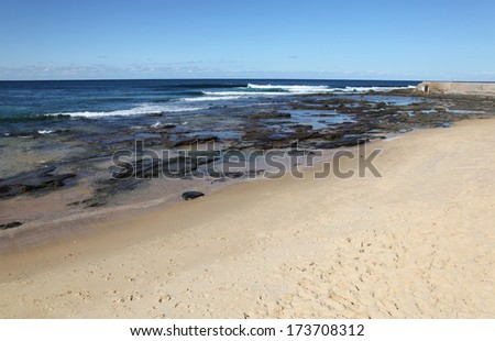 A lovely day on the beach at the Cowrie Hole adjacent to Newcastle Beach Australia. Newcastle is Australia\'s second oldest city and its innner city beaches are one of its drawcards.