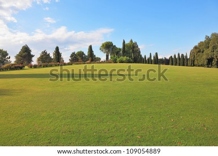 A lovely green lawn grass in a park in northern Italy - stock photo
