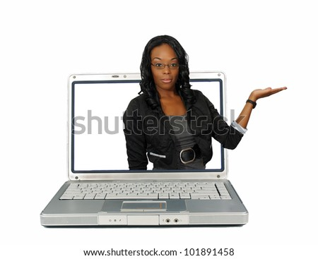 A lovely hostess reaches out of a laptop computer screen, pointing toward frame right.  Place your graphic easily into her flat palm.  Isolated on a white background with generous copyspace.