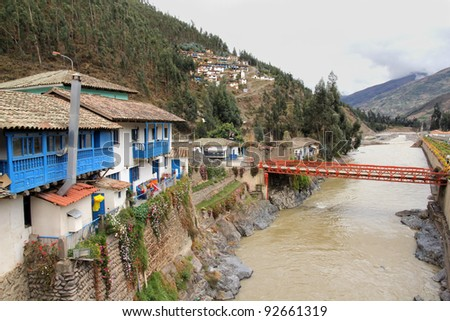 A lovely small mountain village along a river in the Andes Mountains, Peru