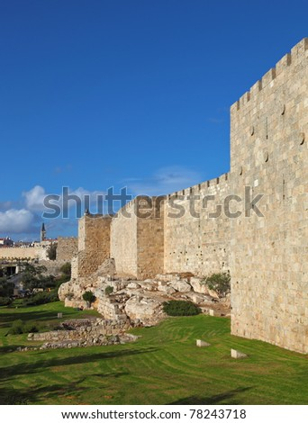 A lovely sunny day in Jerusalem. The walls and towers against the sky and clouds