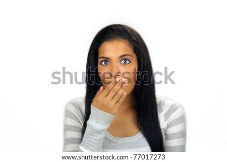 A lovely teenage Latina with long, luscious black hair holds her hand in front of her mouth, apparently shocked or embarrassed.