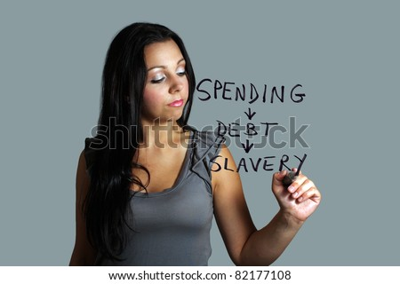 A lovely young black-haired model illustrates the progression from spending, to debt, to slavery, with a heavy marker.