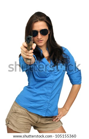 A lovely young brunette points a modern handgun at the camera.  Selective focus on the handgun.  Isolated on a white background with generous copyspace.