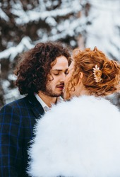 A loving couple in the winter forest. Romantic date