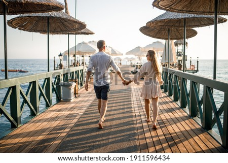 A loving couple is resting at the sea in Turkey. Man and woman on the pier. Sea tour. Honeymoon. Couple on a honeymoon trip. A beautiful couple travels the world. Happy couple on vacation.