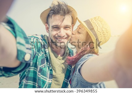 A loving couple takes a self-ie on the beach - lifestyle,people and Holiday concept
