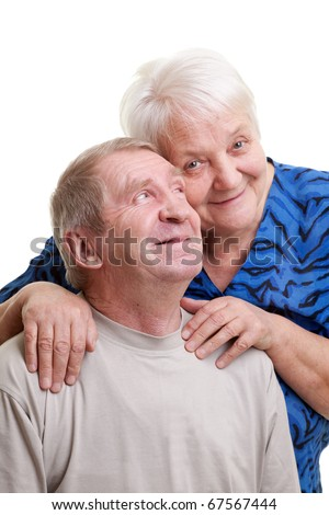 A loving, handsome senior couple on a white background