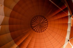 A low angle of the inner side of a vibrant orange air balloon- perfect for wallpapers