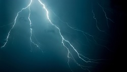 A low angle shot of the scary lightning in the night sky