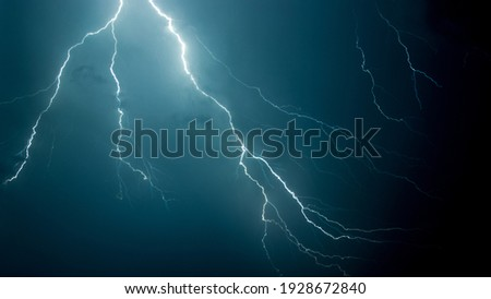 A low angle shot of the scary lightning in the night sky Foto stock ©