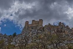 A low angle view of an abandoned castle on the hill on a gloomy day