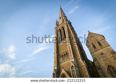 A low angle view up the spire of a typical rural English church.