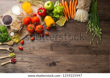 A Low key picture of Healthy food background ,fruits and vegetables on old wooden table.
