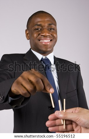 A lucky business man choosing a straw - Focus on the head