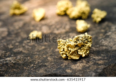 A lump of gold on a stone floor
