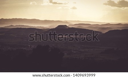 A lush landscape  with mountains in the distance at sunset . Calders,Barcelona.Spain