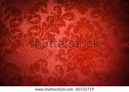 A lush red sofa pattern of swirls