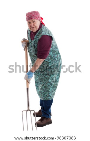 A lusty female senior with pitchfork  looks to viewer 2