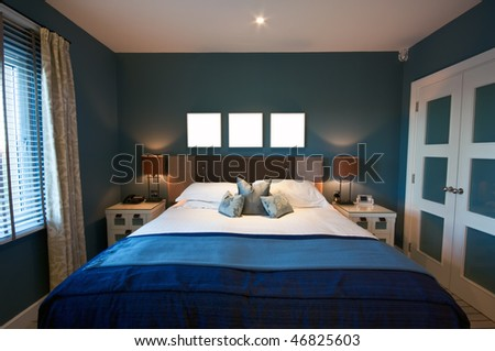 A luxurious modern bedroom on a bright morning. Wardrobe to one side, with window to the other, and three blank square boxes above the bed for your design/text.