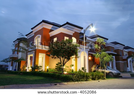 A luxury corner house at sunset
