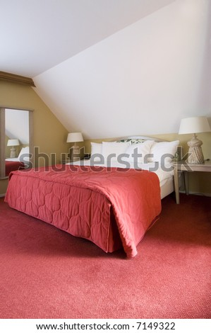 A luxury double bed in a warm