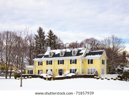 A luxury home covered in snow on a winter day