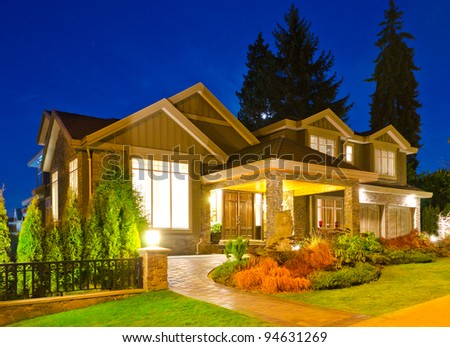 A luxury house in suburbs at dusk in Vancouver, Canada