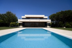 A luxury modern house with a big swimmingpool- Lifestyle concept