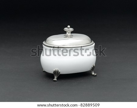 A luxury porcelain sugar bowl with a pewter lid for tea or coffee time