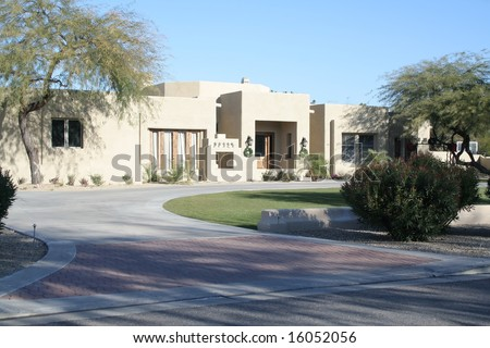 A luxury upscale home in an Arizona suburb - stock photo