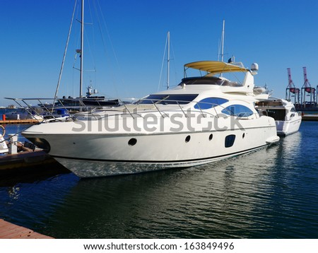 A luxury yacht at the yacht club in the port stock photo