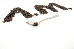 A.M. for morning, made from coffee beans; focus is on teaspoon with a bean