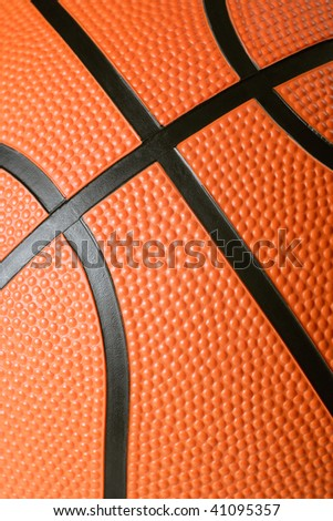A macro background image of the texture of a basketball. Focus is in the middle.