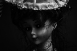 A macro close up black and white photography of a toy miniature girl picture.