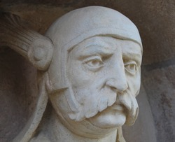 A macro close up view of stone statue head in the Fishermans Bastion in the Buda Castle.