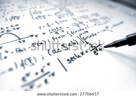 A macro image of a pencil writing math equations on a sheet of paper.