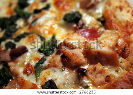 A macro of mediterrainian pizza, shot with a shallow depth of field. - stock photo