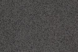 A macro photo of a black gradient color with texture from real foam sponge paper for background, backdrop or design.