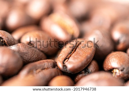 A macro photo of fried brown coffee beans on the table. Freshly roasted coffee beans background Photo stock ©
