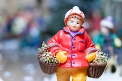 A macro photograph of a porcelain Christmas figurine in a Christmas mockup