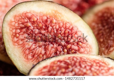 A macro photography image of sliced fig fruit. you can see the seeds and inside of the fruit. the textured fruit. Ficus carica #1482731117