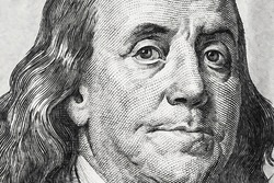 A macro portrait of Benjamin Franklin on the one hundred dollars banknote. Close up.