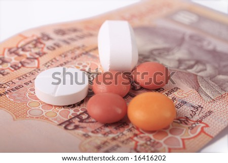 A macro representing the high cost of health care; Indian currency with Gandhi s face on the background.
