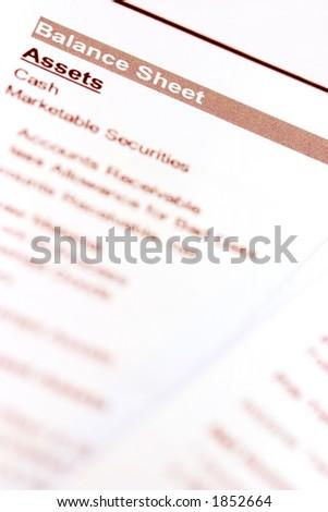 """A macro shot of a balance sheet document. Focus on """"balance sheet""""."""