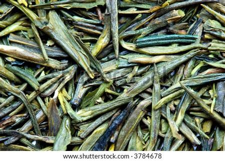 a macro shot of a dry green tea