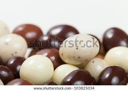 A macro shot of a variety chocolate covered espresso beans. Shallow Depth of Field.