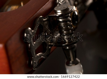A macro shot of acustic guitar machine heads used for tuning str stock photo
